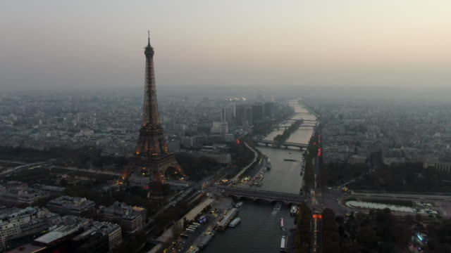 aerial: paris cityscape with river seine and eiffel tower, france - river seine stock videos & royalty-free footage