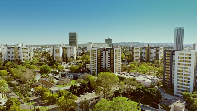 ws aerial park la brea 13-story tall historic apartment towers built in 1941 as part of a garden city featuring expansive open green spaces - 1941 stock videos & royalty-free footage