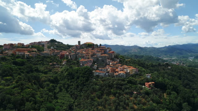 aerial pedestal shot of a mountain side community, vezzano ligure, italy - italian culture stock videos & royalty-free footage