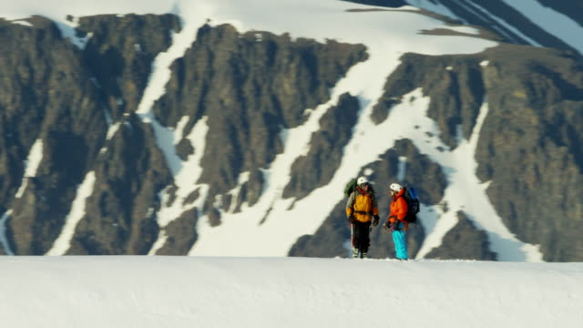 Aerial people climbing a snow covered mountain Alaska