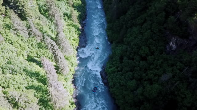 aerial: people paddling through rough water - rapid stock videos & royalty-free footage