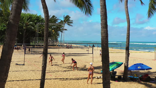 aerial: people playing volleyball at beach during vacation on sunny day - oahu, hawaii - perfection stock videos & royalty-free footage