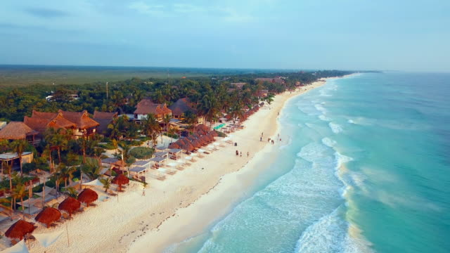 aerial: people walking and relaxing on beach - tulum mexico stock videos & royalty-free footage