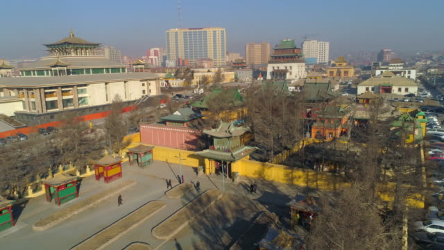 aerial: people walking around a plaza outside the city of ulaanbaatar - independent mongolia stock videos & royalty-free footage