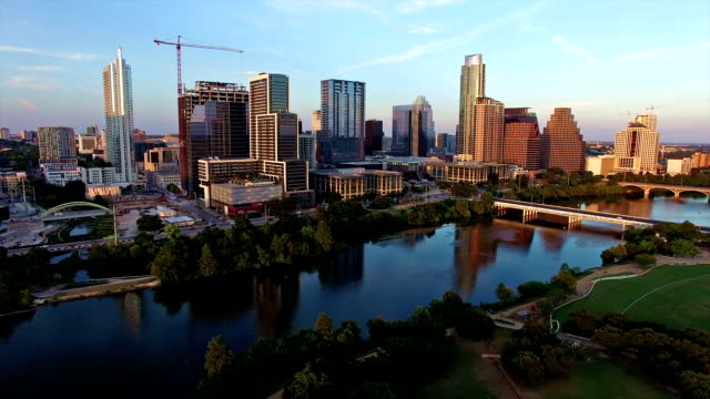 aerial: perfect austin texas sunset over downtown town lake - postmodern stock videos and b-roll footage