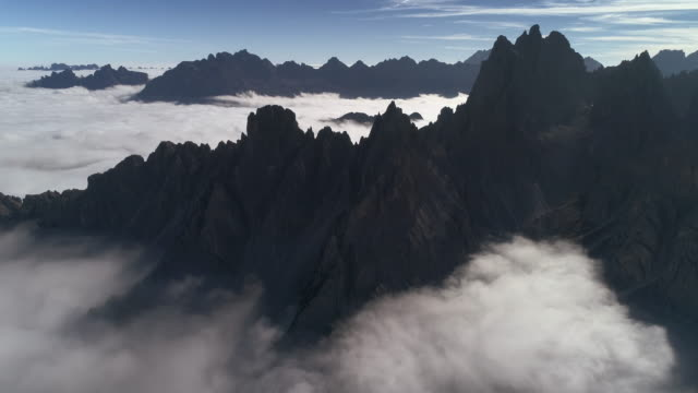 aerial perspective above the clouds and mountains, tre cime di lavaredo, dolomites, italy - tre cimo di lavaredo stock videos & royalty-free footage