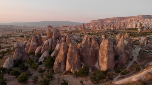 aerial perspective flying close to iconic desert rock formations, at sunrise - dramatic landscape stock videos & royalty-free footage