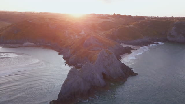 aerial perspective flying over coastline - coastline stock videos & royalty-free footage