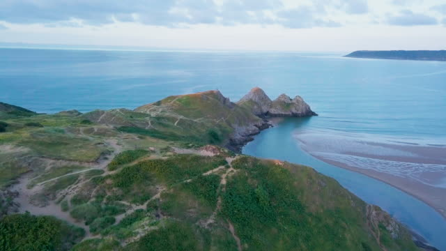 aerial perspective flying over coastline - cliff stock videos & royalty-free footage