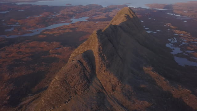 aerial perspective flying over highland mountains - tilt up stock videos & royalty-free footage
