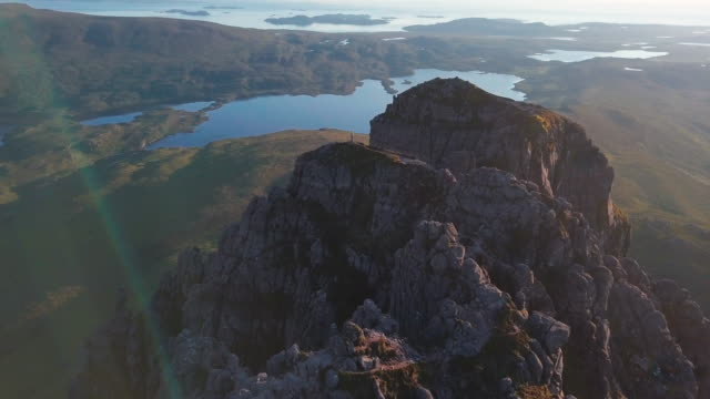aerial perspective flying over rugged coastal mountains at sunrise - twilight stock videos & royalty-free footage