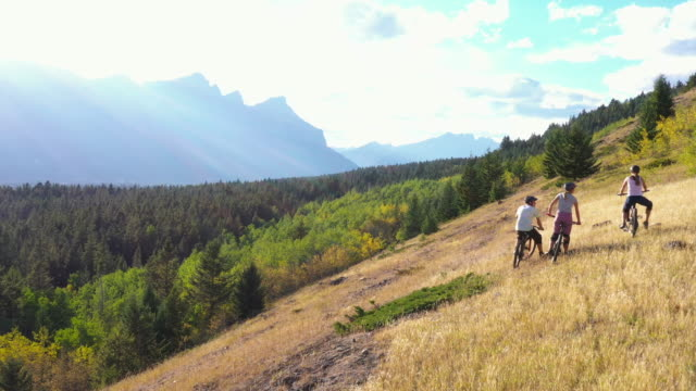 aerial perspective of mountain bikers in clearing - mountain biking stock videos & royalty-free footage