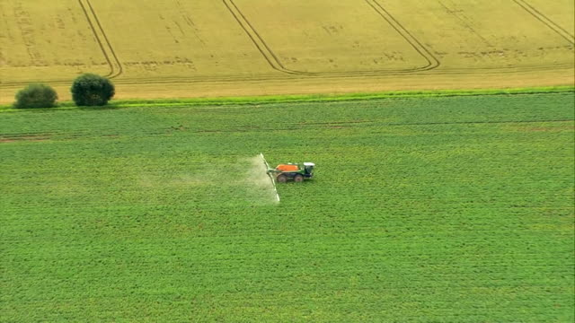 aerial pesticides being sprayed on crops in agricultural field - insecticide stock videos & royalty-free footage