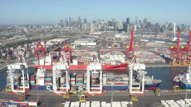 aerial photo of the port of melbourne container terminal with melbourne cbd in the background. it is australia's busiest cargo port - docks stock videos & royalty-free footage