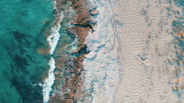 aerial photograph of the beach and turquoise colored sea - island stock videos and b-roll footage