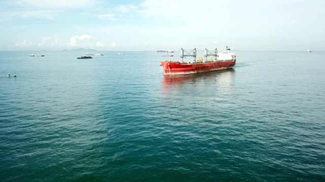 aerial photos of container ships go to the harbor - tanker stock videos & royalty-free footage