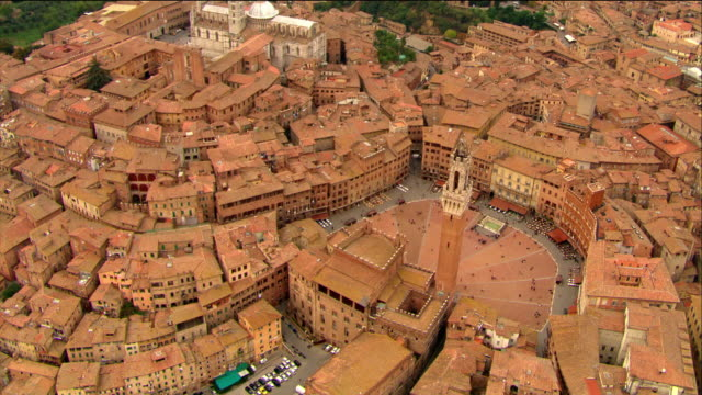 aerial piazza del campo / circling over palazzo pubblico and torre del mangia / siena, italy - tuscany stock videos & royalty-free footage