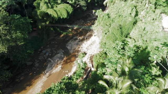aerial: picturesque suspension bridge over dry river bed in the jungle - hispaniola stock videos & royalty-free footage