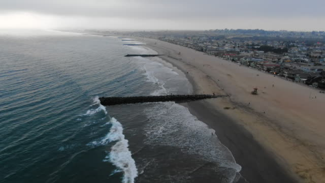 aerial: piers on huntington beach after sunset - huntington beach, california - huntington beach california stock videos and b-roll footage