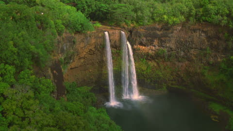 aerial point of view approaching and passing over wailua falls / kauai, hawaii - kauai stock videos & royalty-free footage