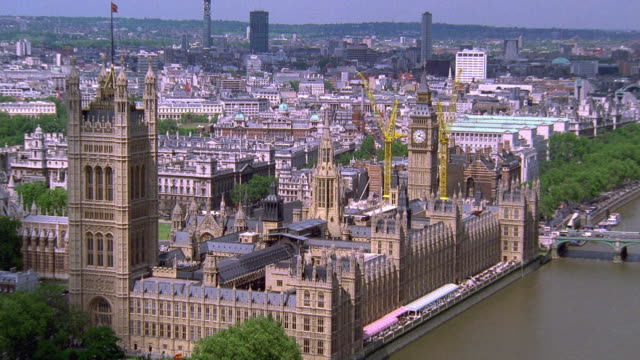 aerial point of view around big ben and parliament buildings / london - parliament building stock videos & royalty-free footage