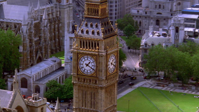aerial point of view around big ben with houses of parliament and westminster abbey in background / london - parliament building stock videos & royalty-free footage