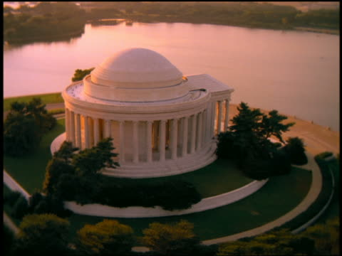 Aerial point of view around Jefferson Memorial with Potomac River and city in background / Washington D.C.