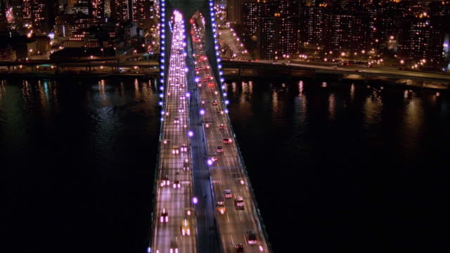 aerial point of view brooklyn bridge and manhattan at night / new york city - 1998 stock-videos und b-roll-filmmaterial