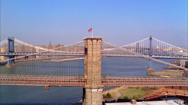 aerial point of view brooklyn bridge and manhattan bridge / dumbo + lower manhattan skylines - brooklyn bridge stock videos & royalty-free footage