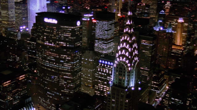 aerial point of view chrysler building and manhattan at night / new york city - chrysler building stock-videos und b-roll-filmmaterial