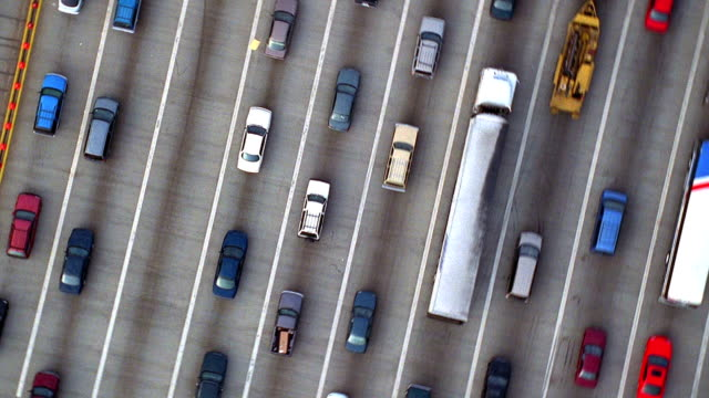 aerial point of view circling over traffic at toll booth on highway / baltimore, maryland - ingorgo stradale video stock e b–roll