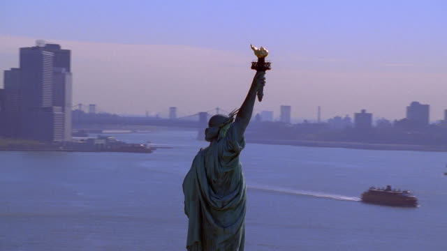 aerial point of view circling statue of liberty and  ny harbor / new york city - hd format stock-videos und b-roll-filmmaterial