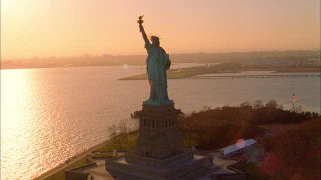 Aerial point of view circling Statue of Liberty and  NY Harbor