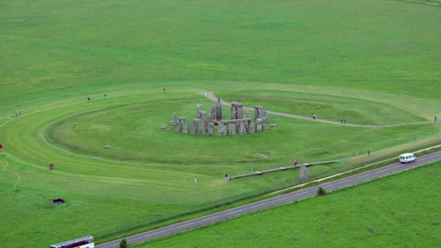 aerial point of view crossing road over stonehenge / england - obelisk stock videos & royalty-free footage