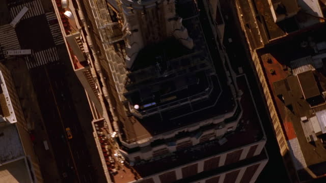 aerial point of view medium shot around and overhead empire state building radio tower - 1999 stock videos & royalty-free footage
