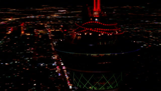Aerial point of view medium shot of top of Stratosphere Tower at night / Las Vegas, Nevada