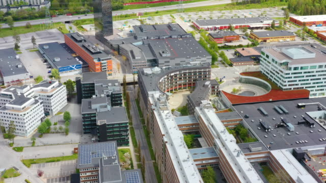 aerial point of view of kista, stockholm, moving sideways, highway in background - panning stock videos & royalty-free footage