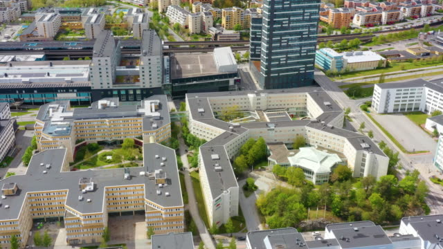 aerial point of view of kista, stockholm, subway in background - panning stock videos & royalty-free footage