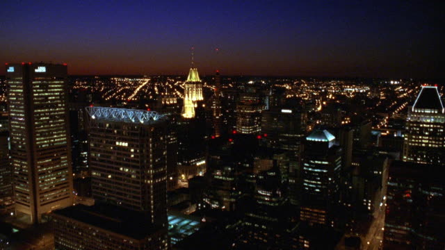 aerial point of view over baltimore harbor, towards and over downtown at night / maryland - baltimore maryland stock videos & royalty-free footage