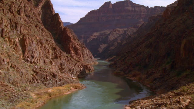 aerial point of view over colorado river in grand canyon / arizona - grand canyon video stock e b–roll