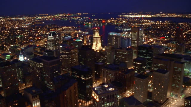 Aerial point of view over downtown Baltimore, towards and over harbor at night / Maryland
