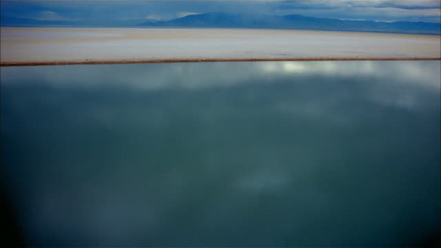 Aerial point of view over Great Salt Lake and salt flats / Utah