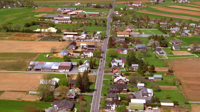 aerial point of view over main road of rural town / smoketown, pennsylvania - ペンシルベニア州点の映像素材/bロール