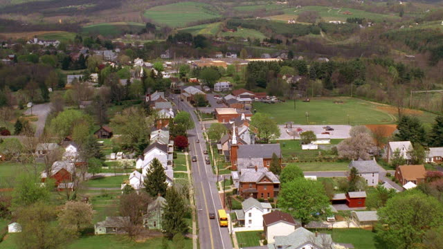 stockvideo's en b-roll-footage met aerial point of view over rural road and town / pennsylvania - pennsylvania