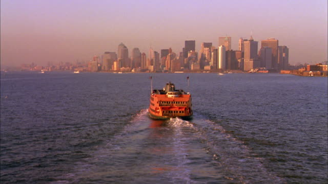 aerial point of view over staten island ferry traveling toward manhattan - new york harbor stock videos & royalty-free footage