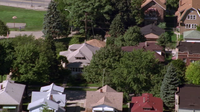 aerial point of view over suburban chicago neighborhood / illinois - residential district stock videos & royalty-free footage
