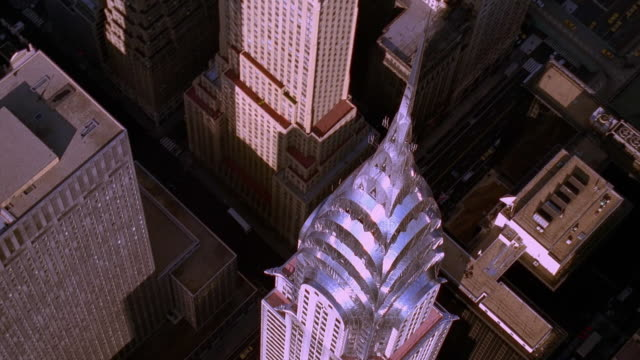 aerial point of view overhead and around chrysler building's art deco spire / nyc - chrysler building stock-videos und b-roll-filmmaterial