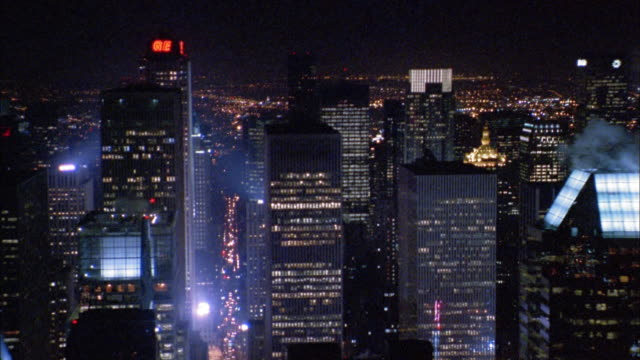 aerial point of view passing chrysler building and midtown manhattan buildings at night - manhattan stock-videos und b-roll-filmmaterial