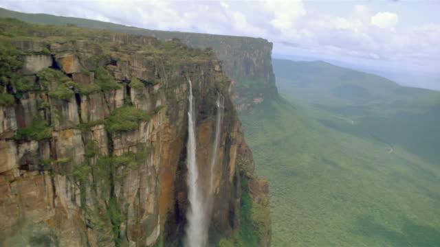 aerial point of view through canyon / waterfall running through rocks / venezuela - venezuela stock videos & royalty-free footage