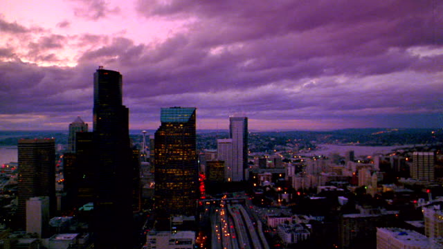 Aerial point of view toward and over downtown Seattle past Bank of America Tower + Key Tower at dusk / Washington